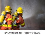 2 firefighters in protection... | Shutterstock . vector #489494608