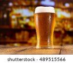 glass of beer in a bar | Shutterstock . vector #489515566