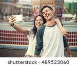 couple dating amusement park... | Shutterstock . vector #489523060