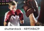 Boy Training Boxing Exercise...