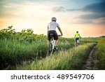 man and woman riding bicycles... | Shutterstock . vector #489549706