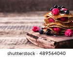 buckwheat pancakes with berry... | Shutterstock . vector #489564040
