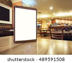 mock up menu frame on table in... | Shutterstock . vector #489591508