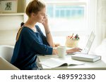 Stock photo side view portrait of young beautiful casual woman making call using smartphone talking on phone 489592330