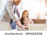businessman pointing at tablet... | Shutterstock . vector #489606508
