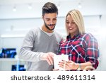 couple buying a new tablet in a ... | Shutterstock . vector #489611314