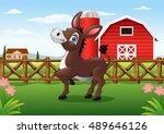 cartoon happy donkey with farm... | Shutterstock .eps vector #489646126