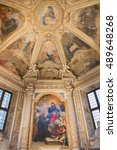 Small photo of ROME, ITALY - MARCH 9, 2016: The Mellini chapel in church Basilica di Santa Maria del Popolo with the altarpiece by Agostino Masucci (st. Augustine presents St. Nicholas to Virgin Mary) from 18. cent.