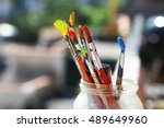 photo of paint brushes in a jar | Shutterstock . vector #489649960