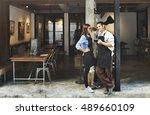couple barista coffee shop... | Shutterstock . vector #489660109