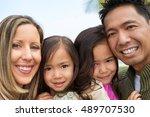 beautiful diverse family | Shutterstock . vector #489707530