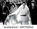 bride in a furcoat walks with... | Shutterstock . vector #489730564