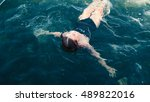the girl swims in the sea on a... | Shutterstock . vector #489822016