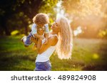 beautiful young mother with her ... | Shutterstock . vector #489824908