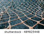 Old Fishing Net In The Sea Water