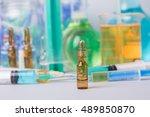 syringe with ampules of drugs | Shutterstock . vector #489850870