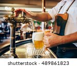 bartender pouring the fresh... | Shutterstock . vector #489861823