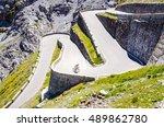 alone biker on the asphalt road ... | Shutterstock . vector #489862780