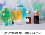 syringe with ampules of drugs | Shutterstock . vector #489863740