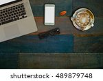 wood desk with office supplies... | Shutterstock . vector #489879748