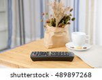 the remote control is placed on ... | Shutterstock . vector #489897268