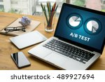 a b test laptop on table. warm... | Shutterstock . vector #489927694