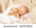 baby girl sleeping tugged in a... | Shutterstock . vector #489953830