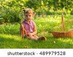 little girl in the garden ... | Shutterstock . vector #489979528