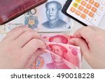 Woman Counting Chinese Yuan...
