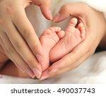 baby feet and mother hands | Shutterstock . vector #490037743