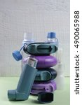 Small photo of Asthma, allergy, illness relief concept, salbutamol inhalers, aerosol medication
