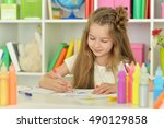little girl drawing at  class | Shutterstock . vector #490129858