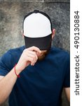 man wearing white bla k cap | Shutterstock . vector #490130884