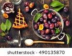 overhead view of fresh plum pie ... | Shutterstock . vector #490135870