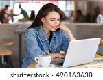 happy freelancer looking into... | Shutterstock . vector #490163638