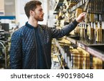 bearded young man in a hardware ... | Shutterstock . vector #490198048