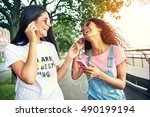 Laughing Female Friends Listen...