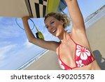 beautiful surfer girl holding... | Shutterstock . vector #490205578