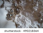 earrings on the lace. top view... | Shutterstock . vector #490218364