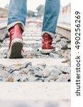 Traveller Walking On Railroad...