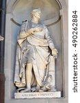 Small photo of FLORENCE, ITALY - January 20, 2016: Amerigo Vespucci ( italian florentine explorer, financier, navigator and cartographer ) statue by Gaetano Grazzini on facade of Uffizi Gallery, Florence, Italy