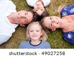 loving family lying in circle... | Shutterstock . vector #49027258