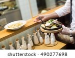 serving of grilled salmon with... | Shutterstock . vector #490277698