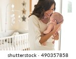 young mother holding her baby... | Shutterstock . vector #490357858