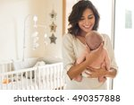 young mother holding her baby... | Shutterstock . vector #490357888