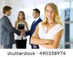 blonde businesswoman looking at ... | Shutterstock . vector #490358974