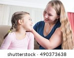 mother and daughter are... | Shutterstock . vector #490373638