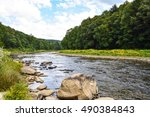 A Small Forested River In...
