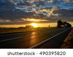 sunset over the asphalt road in ... | Shutterstock . vector #490395820