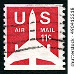 Small photo of UNITED STATES OF AMERICA - CIRCA 1971: A used Air Mail postage stamp from the USA, depicting an illustration of an aircraft, circa 1971.